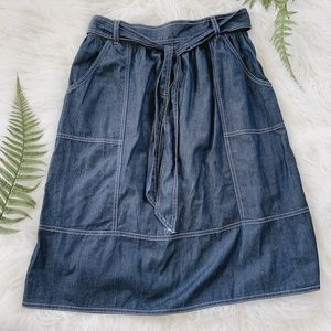 A-line denim style midi skirt with pockets and tie